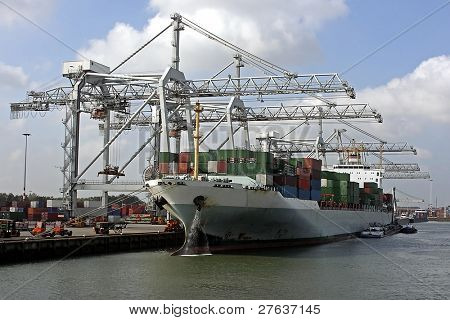 Cargo ship loading in Rotterdam harbor in the Netherlands
