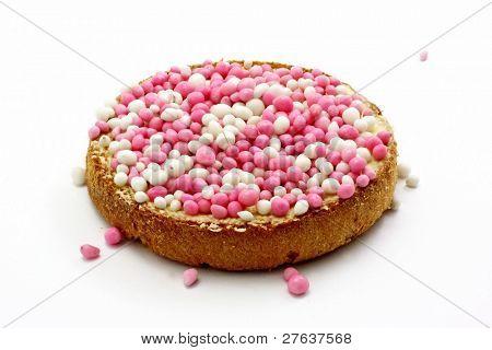 Galleta con mantequilla y bolas de colores, típico manjar holandés cuando un bebé nace, aislado o
