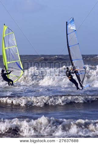 Windsurfers surfing the north sea in the Netherlands