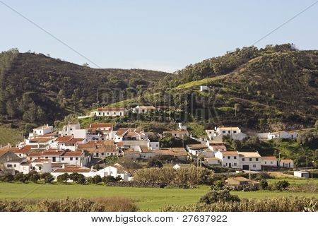 The lovely village Bordeira at the westcoast in the  Algarve in Portugal against the hills