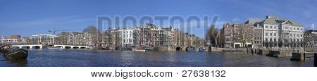 Panoramic cityview with the thiny bridge and theater Carre in Amsterdam the Netherlands