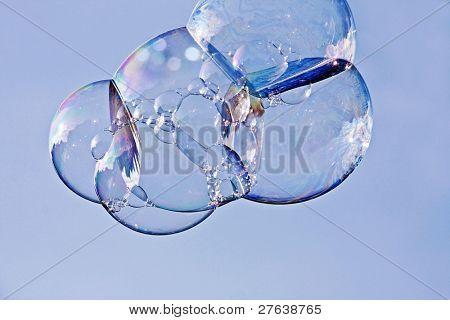 Soap bubbles against a blue sky