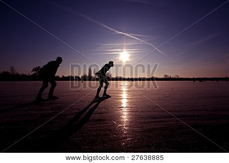 Ice skating in the Netherlands at a beautiful purple sunset
