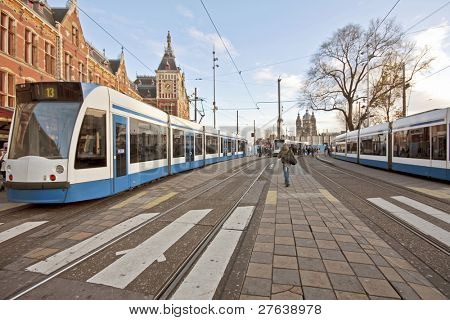 Trams at the central station in Amsterdam the Netherlands