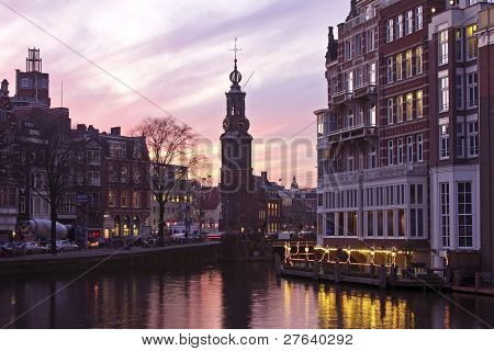 Amsterdam innercity with the Munttower in the Netherlands at twilight
