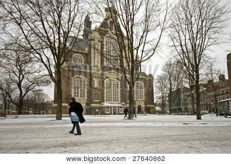 The Westerkerk in the snow in wintertime in the Netherlands