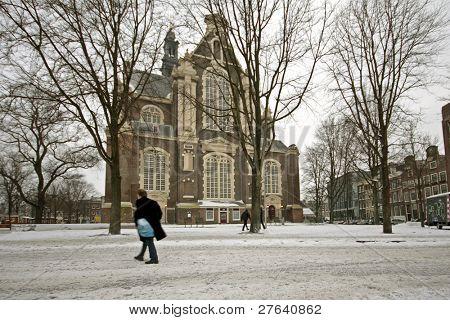 The Westerkerk in the snow in wintertime in the Netherlands