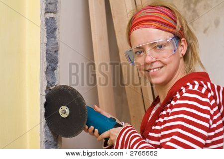 Home Improvement Concept - Happy Woman With A Grinder