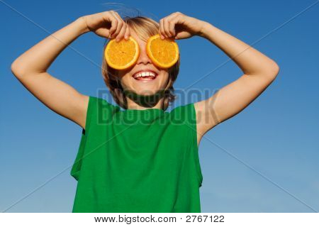 Happy Smiling Child Playing With Fruit