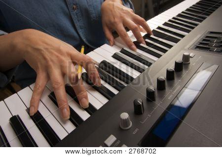 Woman'S Fingers Play Digital Piano Keys