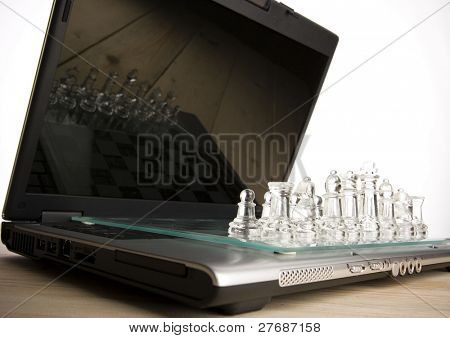Glass chess & Laptop