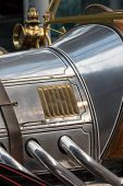 History Of The Automobile. Antique Car In Close-up. Vintage Chrome And Brass Engine Detail On A Clas poster