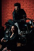 Couple In Garage. Biker Couple In Garage. Couple In Garage With Motorcycle. Sexy Couple Repair Bike. poster