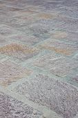 foto of porphyry  - A floor covered with multi colored porphyry - JPG