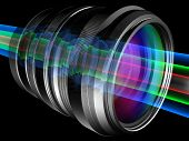 stock photo of diffraction  - Light rays through camera lens 3D rendered illustration - JPG