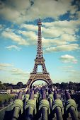Eiffer Tower From Trocadero Quartier In Paris And The Cannons With Old Vintage Toned Effect poster