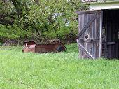 foto of spreader  - abandoned manure spreader by building machine farm - JPG