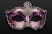 stock photo of mummer  - close up of a purple mask over a dar background