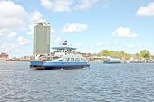 stock photo of ijs  - Ferries on the IJ in Amsterdam the Netherlands - JPG