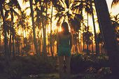 Traveler Girl Ln Tropical Nature In Vacation. Young Girl Traveler Looking To Sunset In Nature. Trave poster