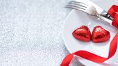 Valentines Day Festive Table Setting With Two Red Heart Shape Chocolate Candies On White Plate, For poster