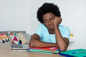 Unmotivated African American Male Student At Desk At Home At Desk poster