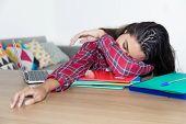Lazy Teenage School Girl At Desk At Home At Desk poster