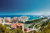 Malaga, Spain. Cityscape Topped View Of Malaga. Plaza De Toros De Ronda Bullring In Malaga, Spain. poster