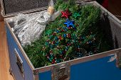 Christmas Tree Decorations Taken Down And Packed Away In Storage. End Or Start Of The Xmas Holiday.  poster