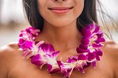 Lei hawaii welcome necklace of fresh orchids flowers garland on womans neck. Aloha spirit. Hula dan poster