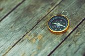 Compass On Wooden Background, Vintage Tone, Journey Planning Concept, Blank Space, Top View, Copy Sp poster