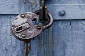 Old Blue Wooden Door Locked With A Padlock. Closed Metal Lock Door Security Protection Padlock poster