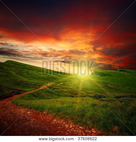 Majestic Sunset And Path Through A Meadow