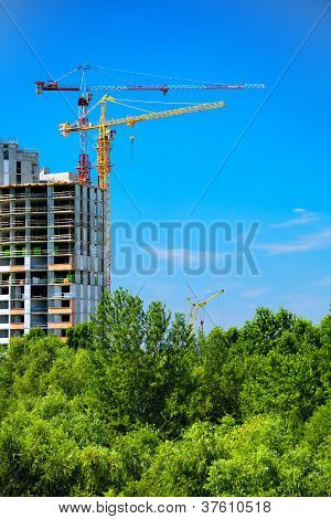 Construction Site With Cranes And Sky