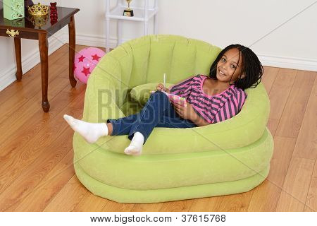 happy young black child relaxing