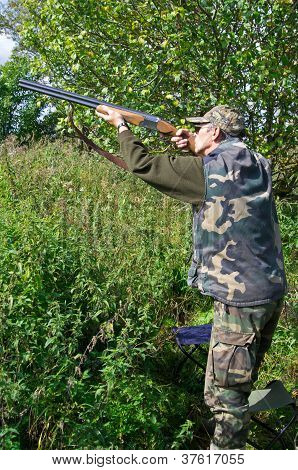 Hunter Shooting Pigeons