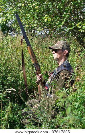 Hunter Hiding In High Grass