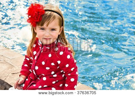 Outdoor Portrait Of Cute Little Girl Near The Water