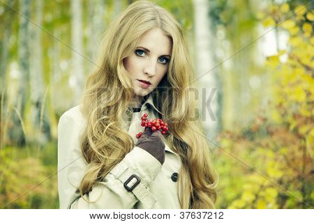 Fashion Portrait Of A Beautiful Young Woman In Autumn Forest