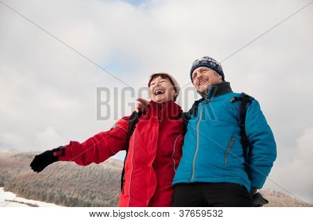 Winter fun - senior retired couple in snow