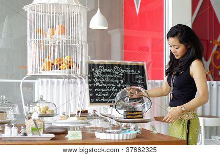 Girl Choosing Cake