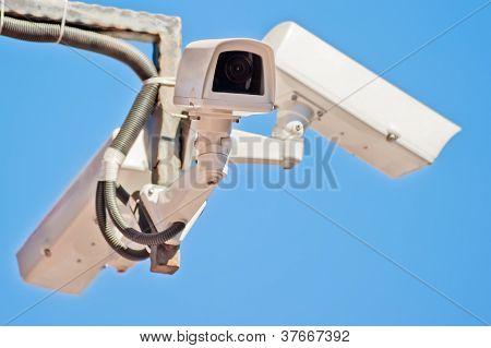 Three outdoor video surveillance camera on the bracket.