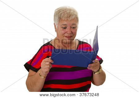 Senior Female Looking  At Statement Of Account