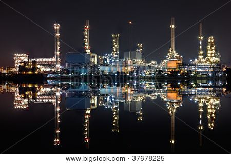 Nightview of Oil refinery factory with reflection