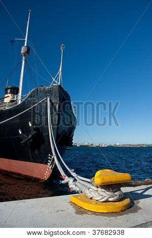Ship Fore With Ropes Attached To Quay