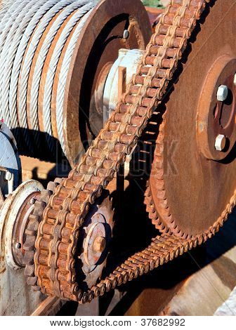 Rusty Chain Transmission Consist Of One Big And A Small Cogwheel And Large Strong Chain