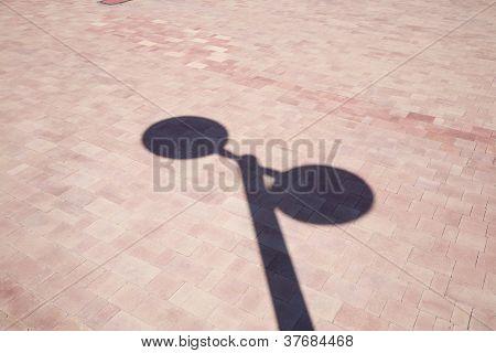 Streetlamp Shadow On Ground