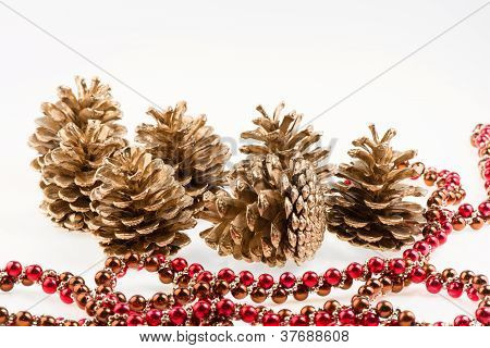 Group Of Seven Golden Pines Cones And Red Garland