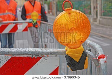 Orange Lamp In A Roadworks In The City