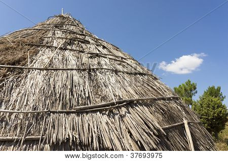 Traditional Straw Hut In Greek Country